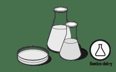 """Ilustracja: Dwie kolby szklane i szalka Petriego symbolizują test na substancje szkodliwe, obok wynik tekstu """"bardzo dobry""""."""