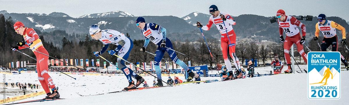 Zdjęcie: Sześciu biegaczy narciarskich w wyścigu, na koszulkach reklama bett1.